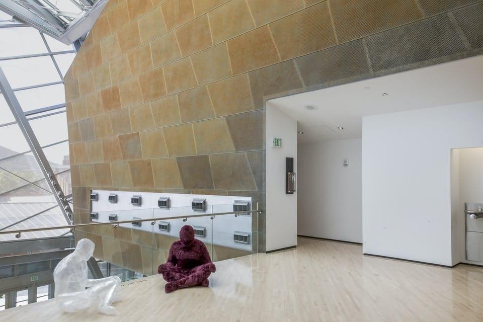 INTERIOR USE OF ROANO ZINC, CUSTOM TRAPEZOIDAL WALL PANELS.