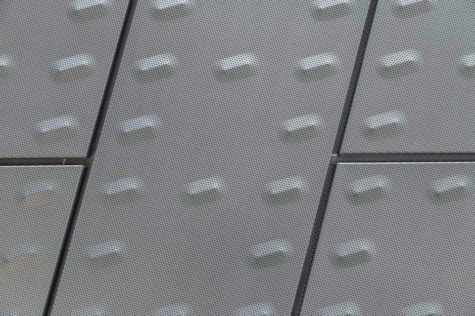 CUSTOM ACOUSTIC METAL TILE PANELS FOR THE KCPD HEADQUARTERS.