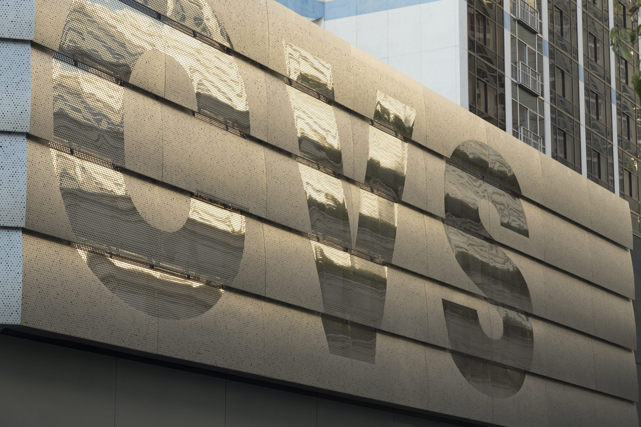 Curved, overlapping ImageWall panels depict the CVS logo