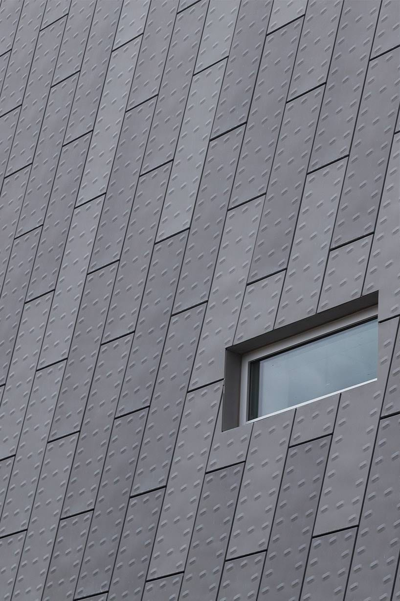 The building facade has an appearance of armored cladding.