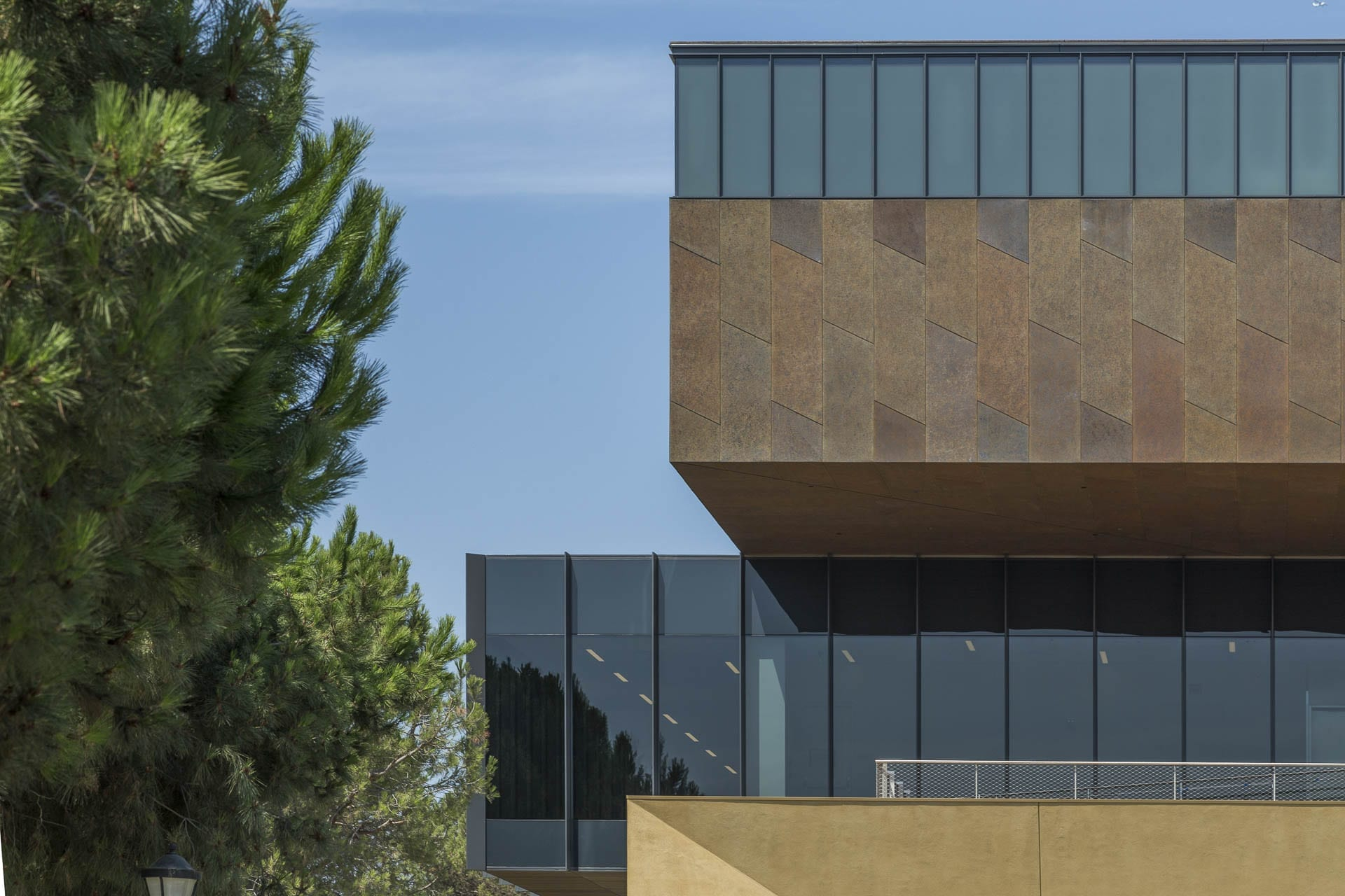 Detail of the cantilevered facade with custom-patinated zinc metalwork, on the McMurtry Building in Stanford, California.