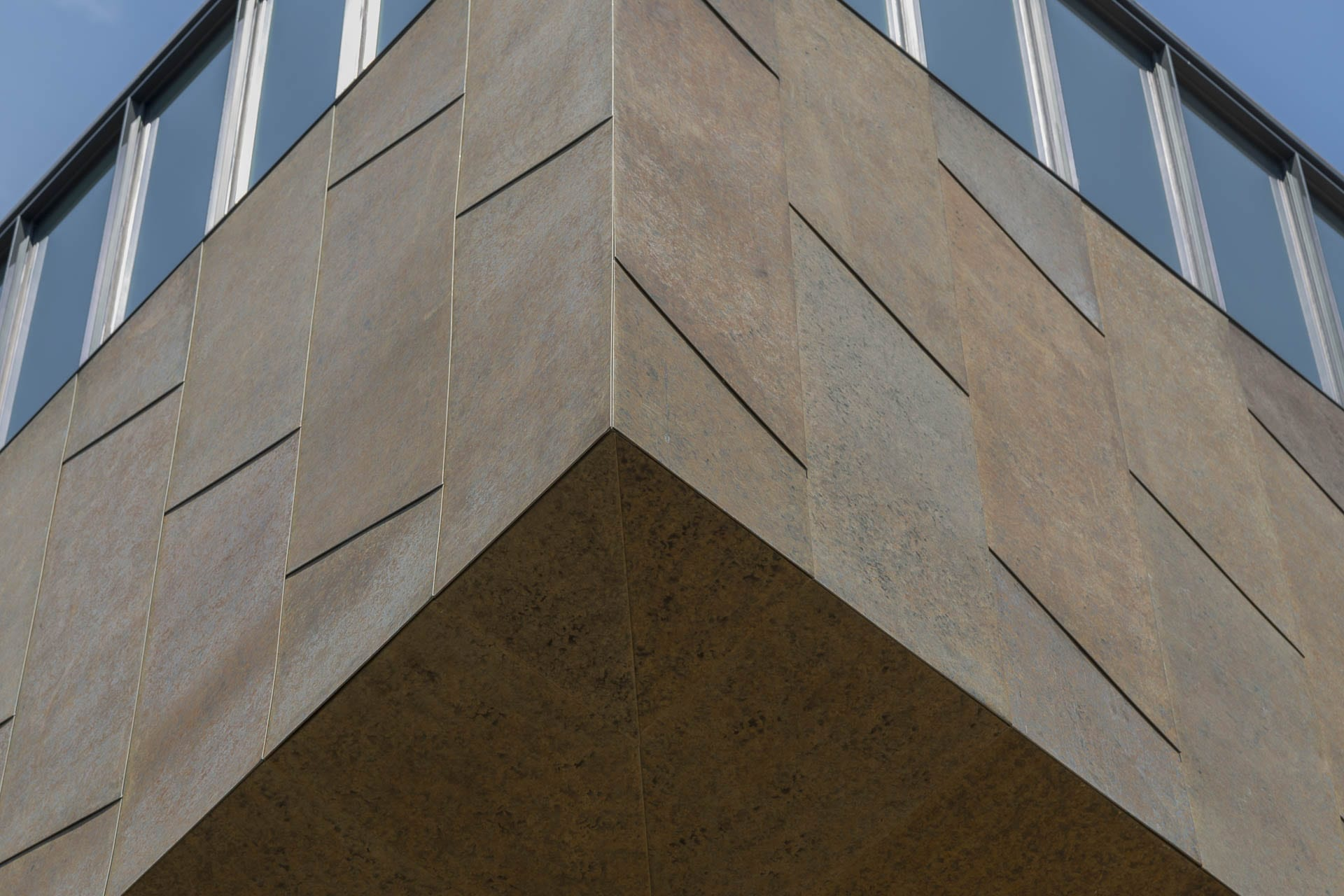 Detail of the custom zinc ceiling corner and facade for the McMurtry Building in Stanford, California.