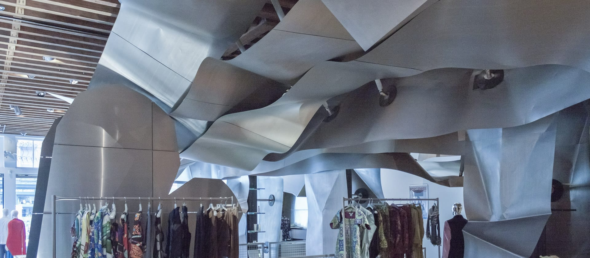 Curving titanium drop ceiling at Issey Miyake Tribeca.