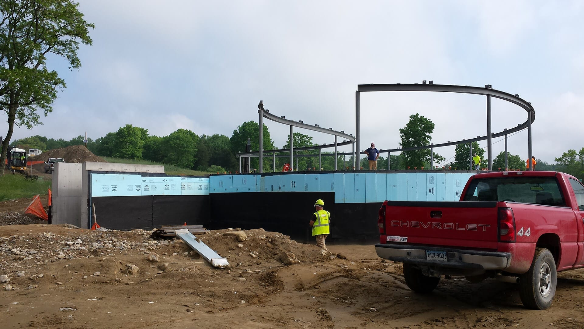 Installers place the structural steel supports for the Grace Farms roof.