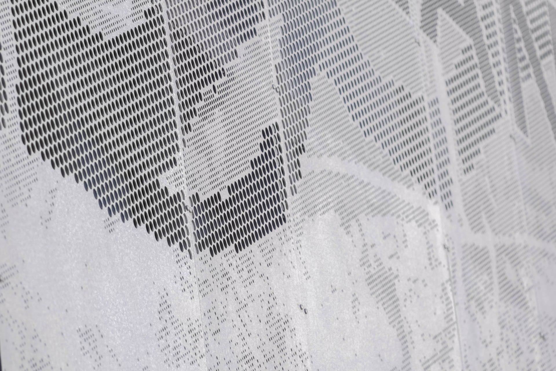 Detail of the ImageWall Perforated Metal Signage used for Highland Park in Minnesota.