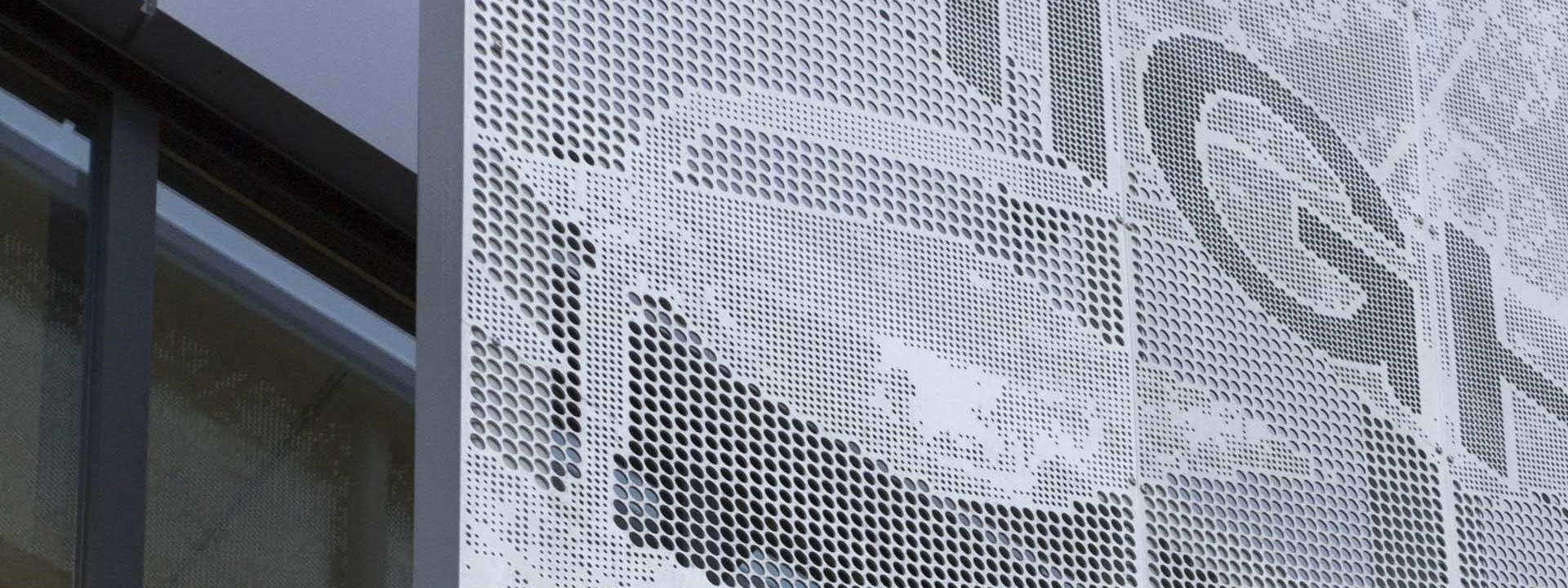 Photo detail of the perforated metal signage for Highland Park Community Center