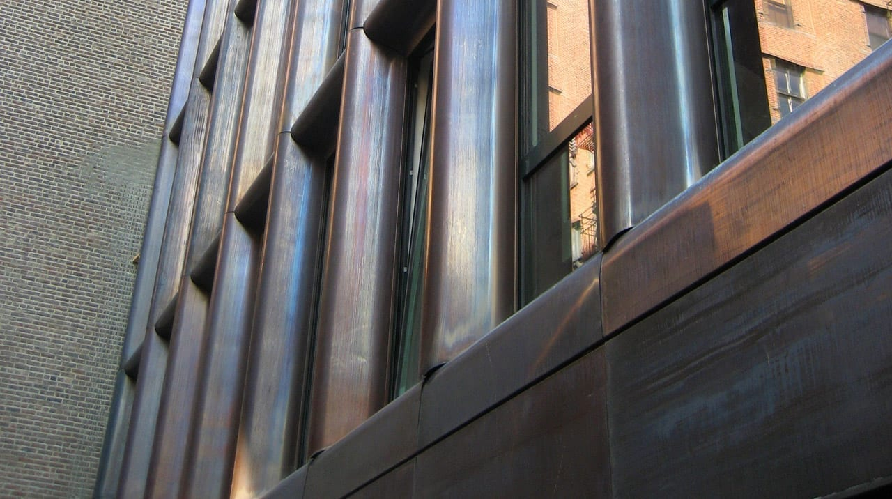 Patinated copper on the building's north elevation.