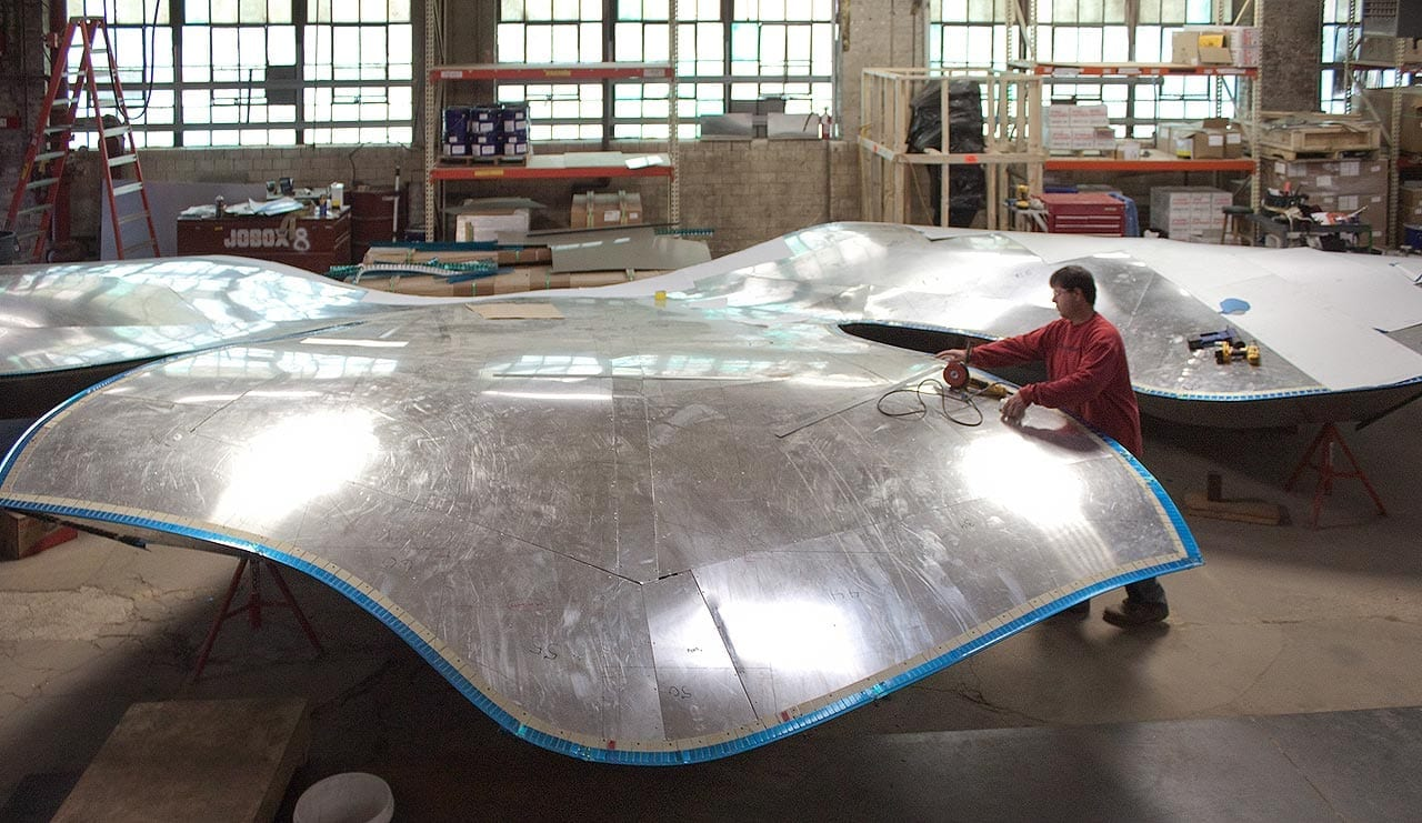 Fabricator in the Zahner shop grinds aligns ZEPPS® Panels.