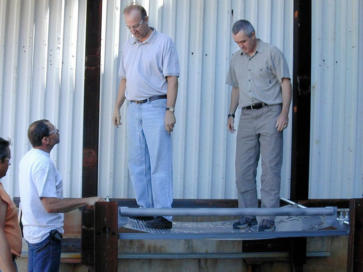 Zahner's Tony Birchler and Wallace Engineering's Steve Huey test the structural load of the individual perforated panel mockup.