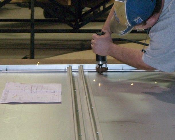 Zahner fabricator installs studs on the backs of NS11 Panels.