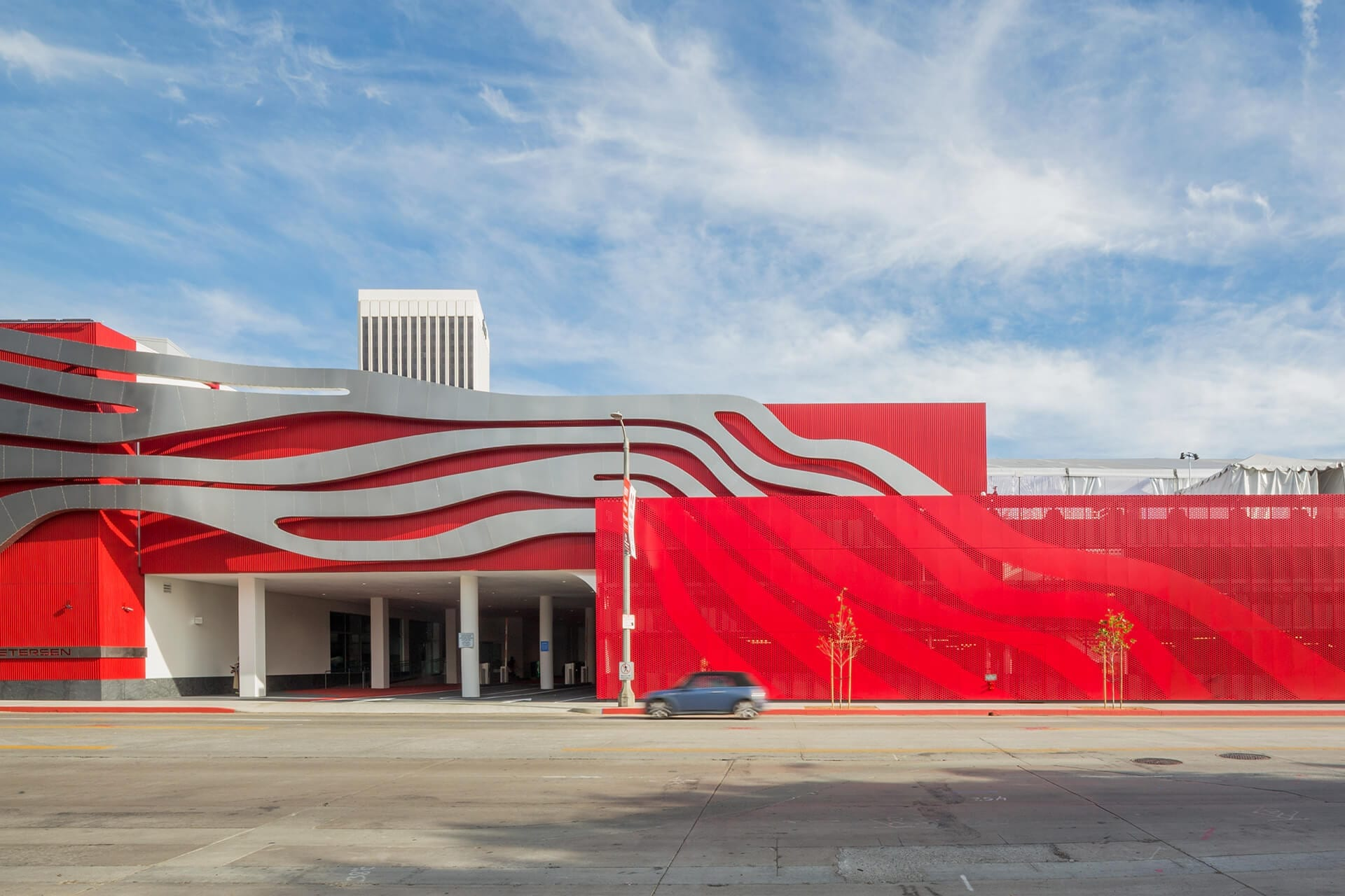 Perforated metal screenwall by Zahner continues the Petersen Automotive Museum's sculptural motif.