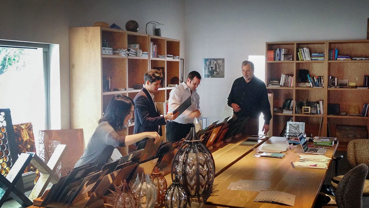 From left: Lisa Iwamoto, Chris Leong, Brad Giresi, Bill Zahner, look at material samples in the Zahner library.