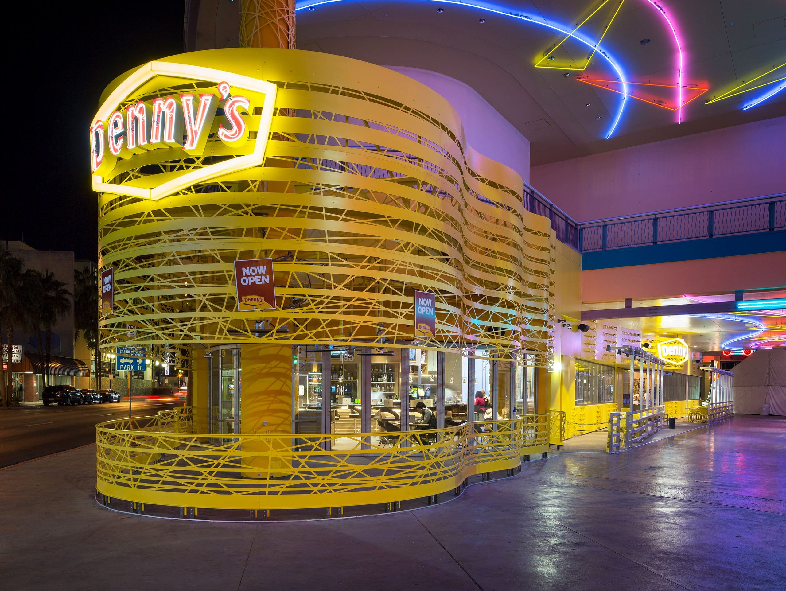 Photograph of the completed Denny's Flagship Diner / Early rendering of the desgin.