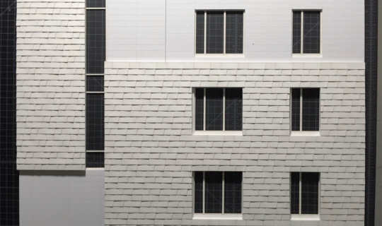 Photo of the ARO-designed custom shingle system and created a physical model