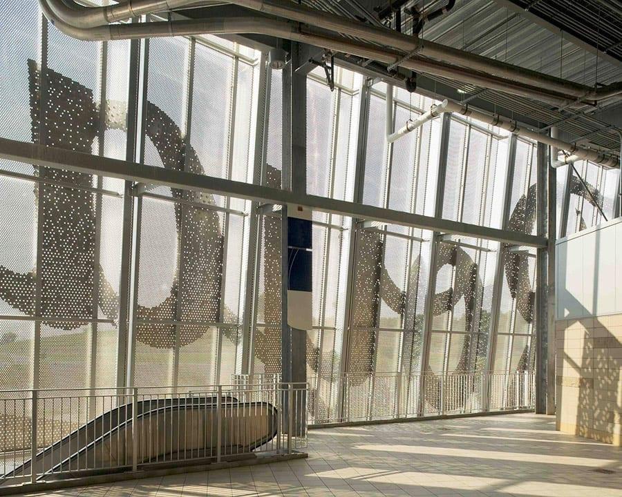 Light flows into through the perforated facade.