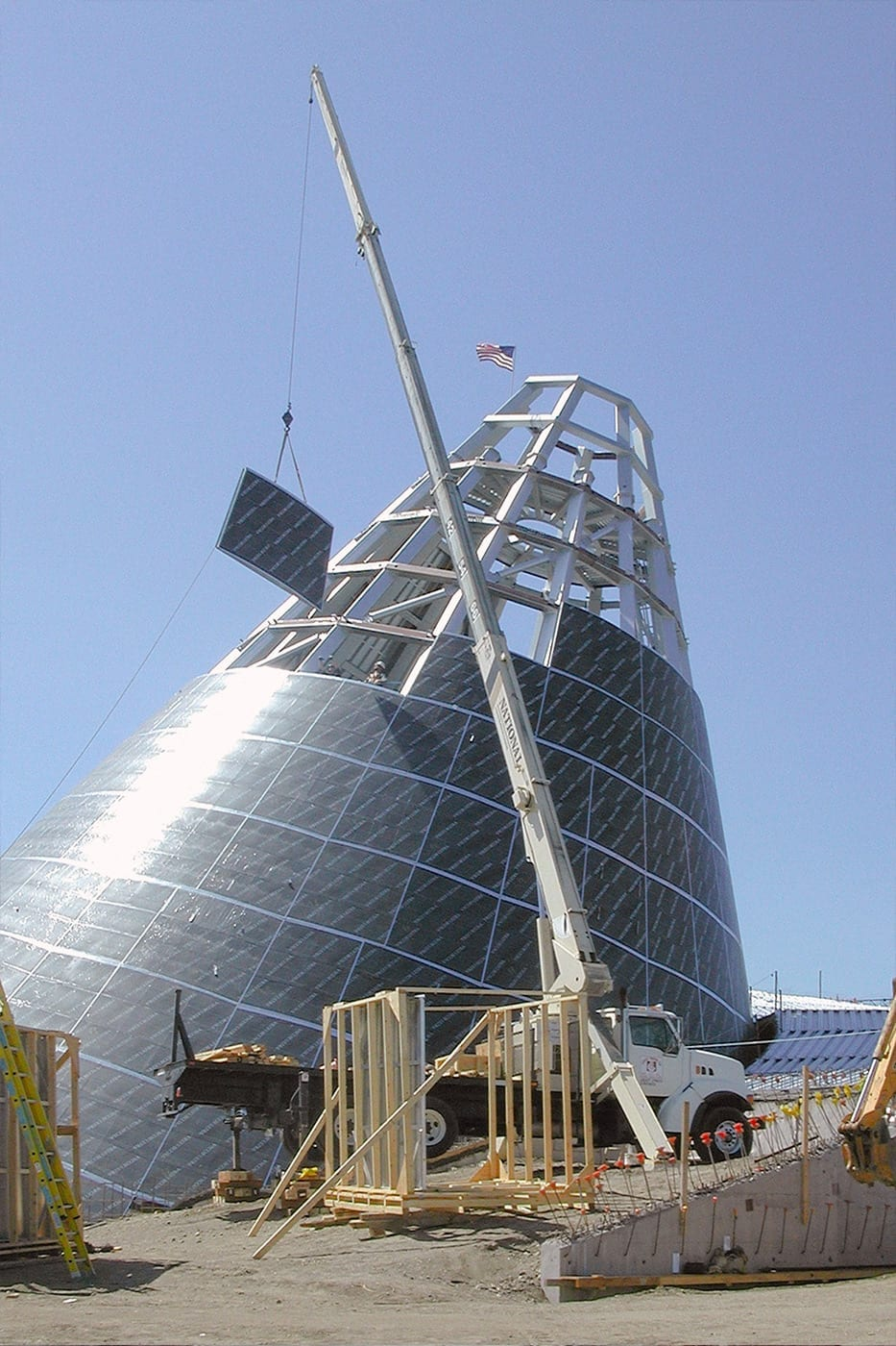 A single ZEPPS assembly is lifted into place on the Museum of Glass