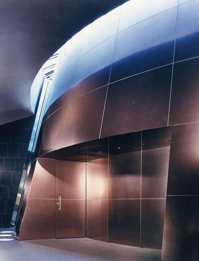The interior titanium surface reflects less light