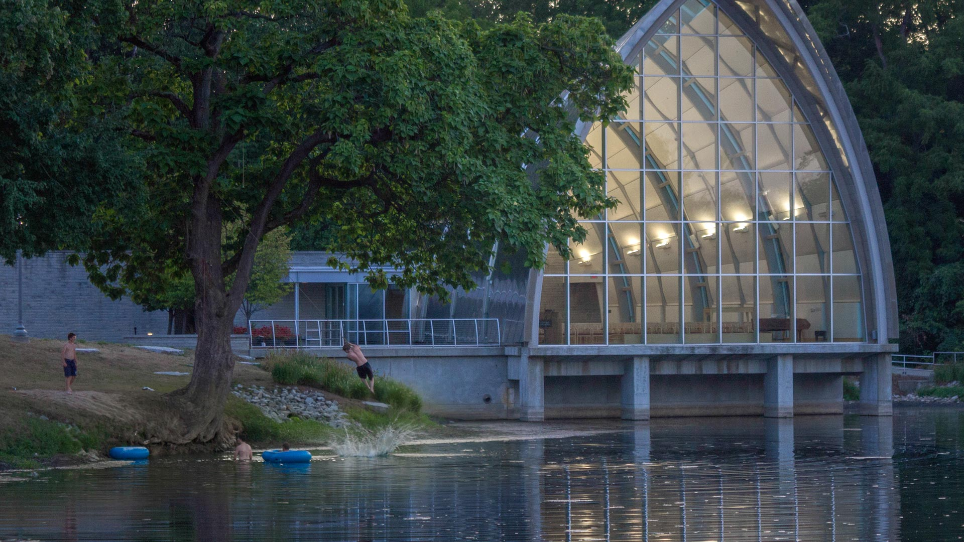Students dive in the lake in front of the chapel at Rose-Hulman.