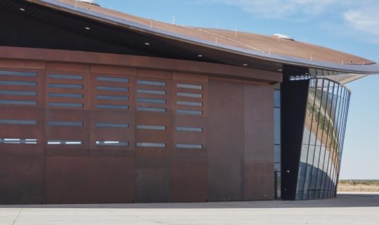 View of the massive Solanum-clad doors on the Spaceport America