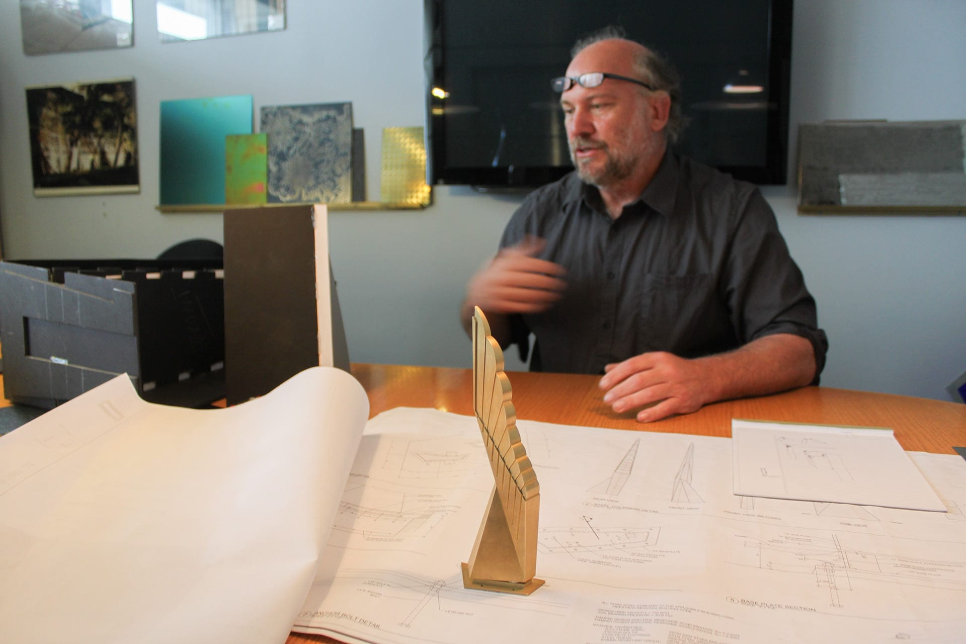 Photograph of John Lajba with his Winged Refuge Sculpture Model.