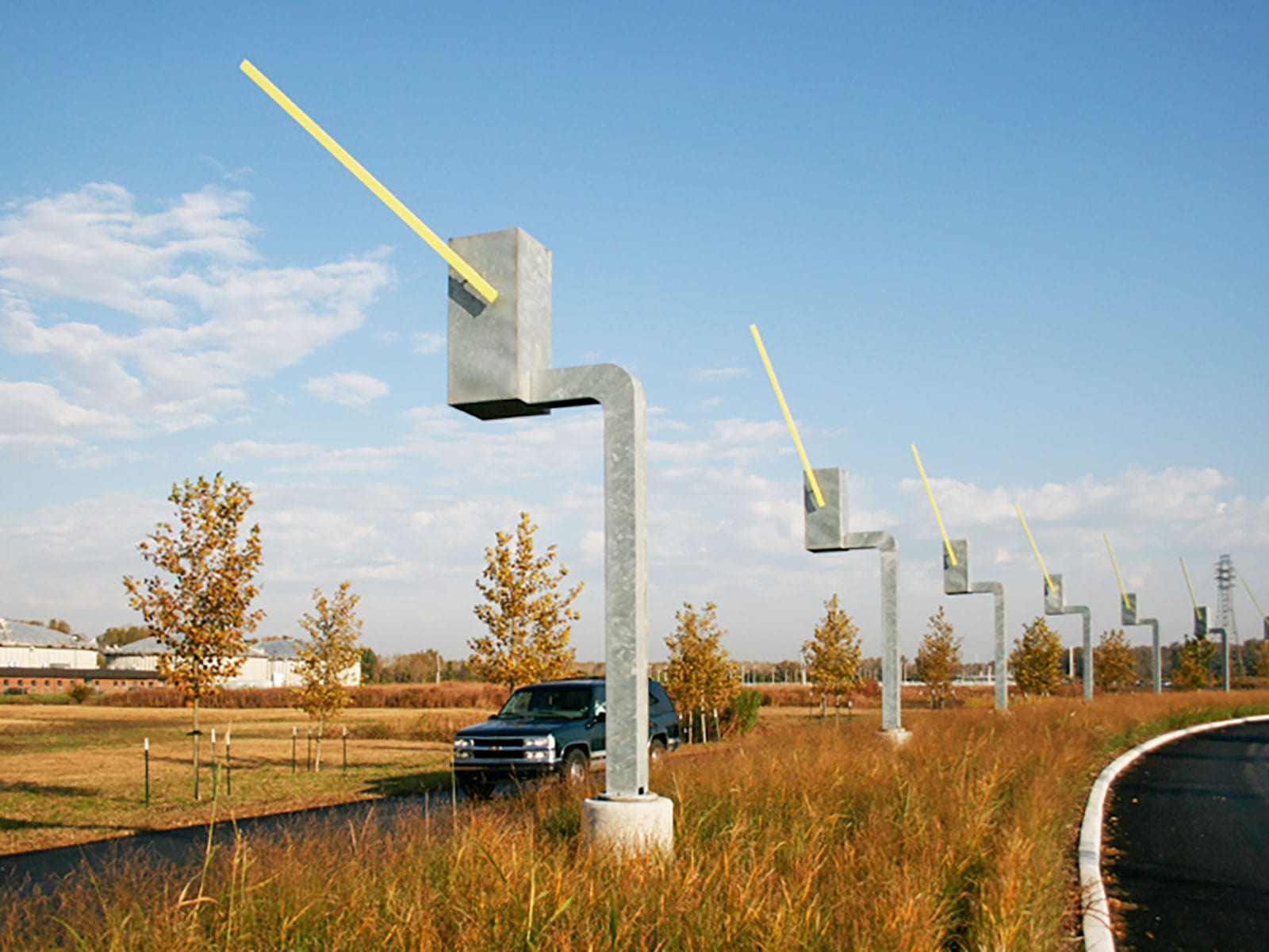 Seven Sentinels kinetic sculpture. Each of the parking gate sculptures salute exiting drivers.