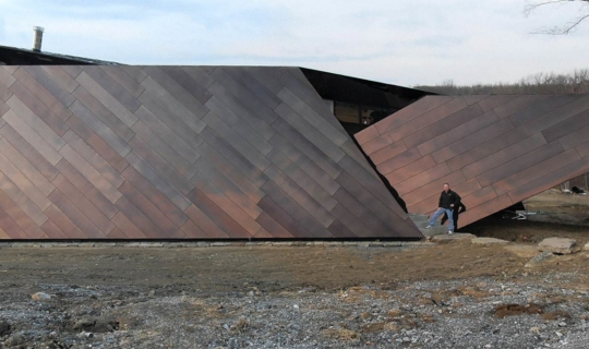 Zahner installer stands in front of the Residence in Connecticut designed by Studio Daniel Libeskind