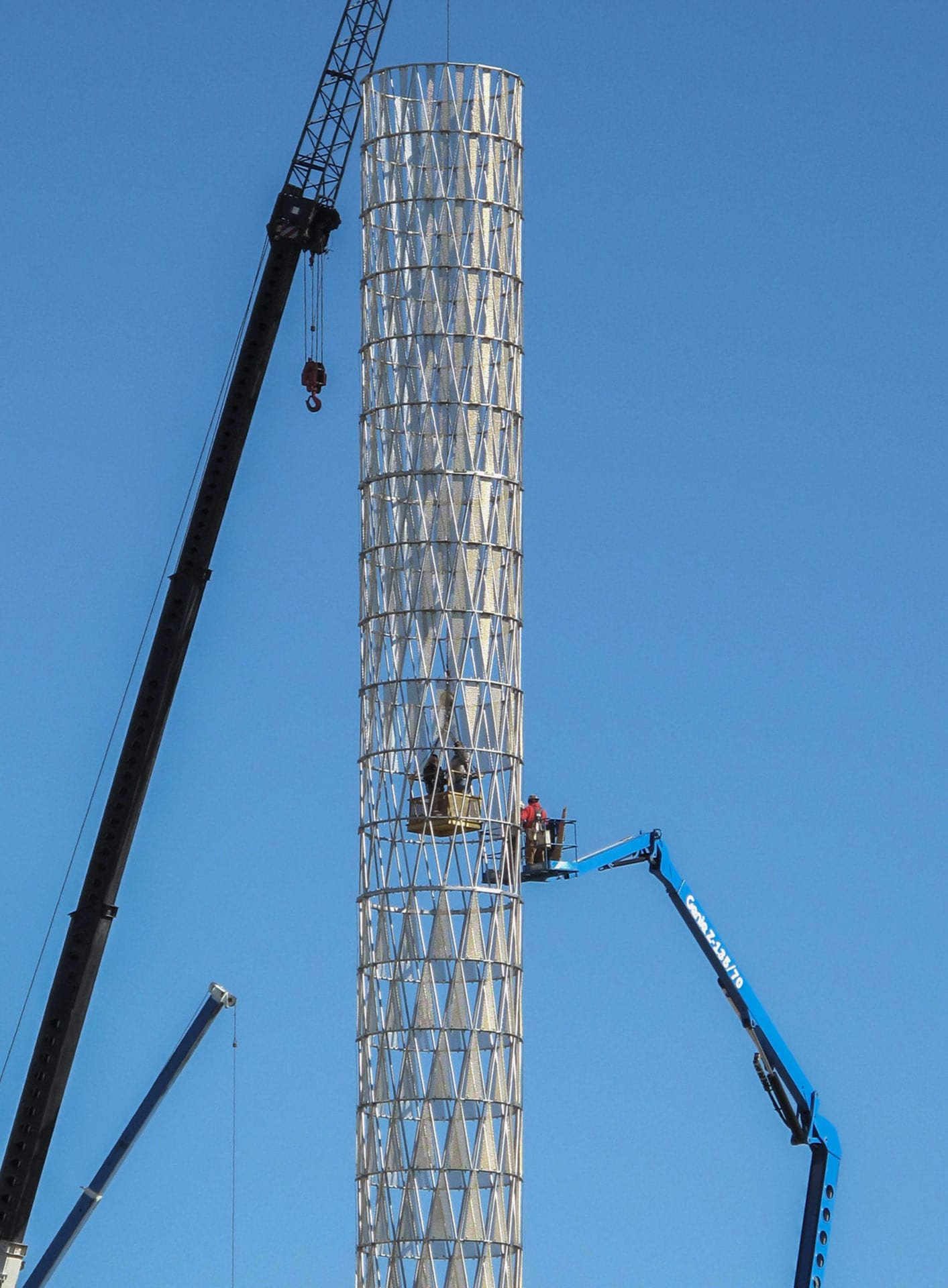 Installers place the triangular curving panels at UNMC in Nebraska.