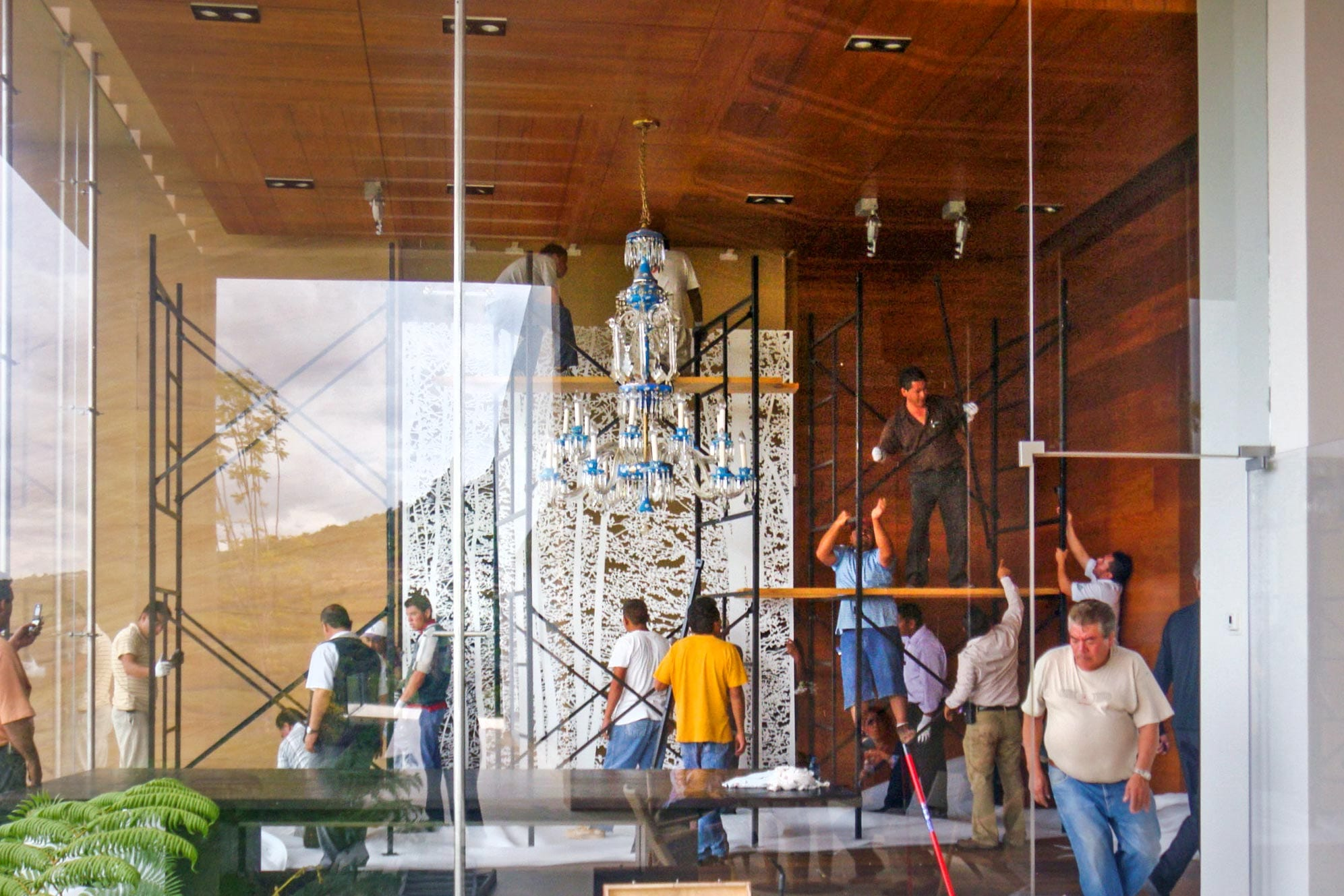 Installers place the large aluminum artwork by Jan Hendrix.