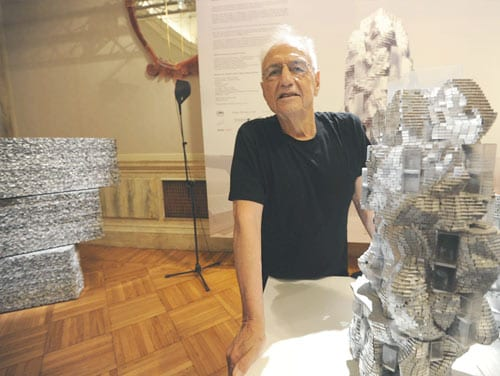 Frank Gehry with model for Parc des Ateliers.