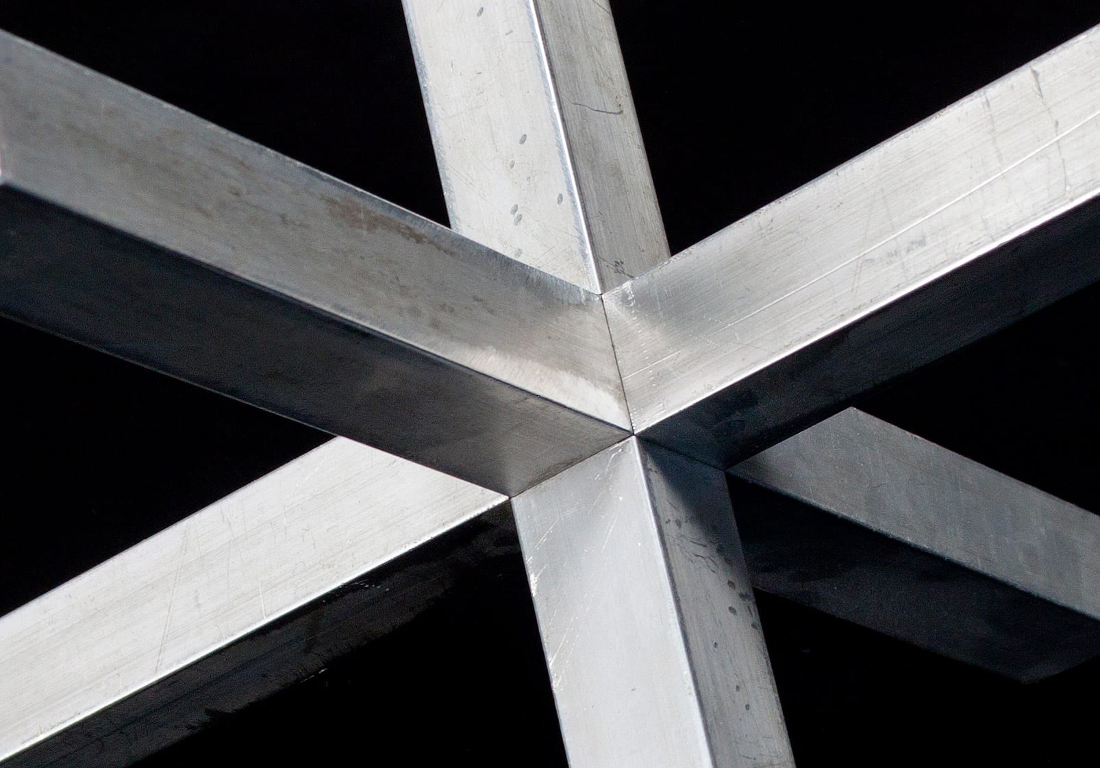 Detail of the aluminum joint prior to painting during the art fabrication process.