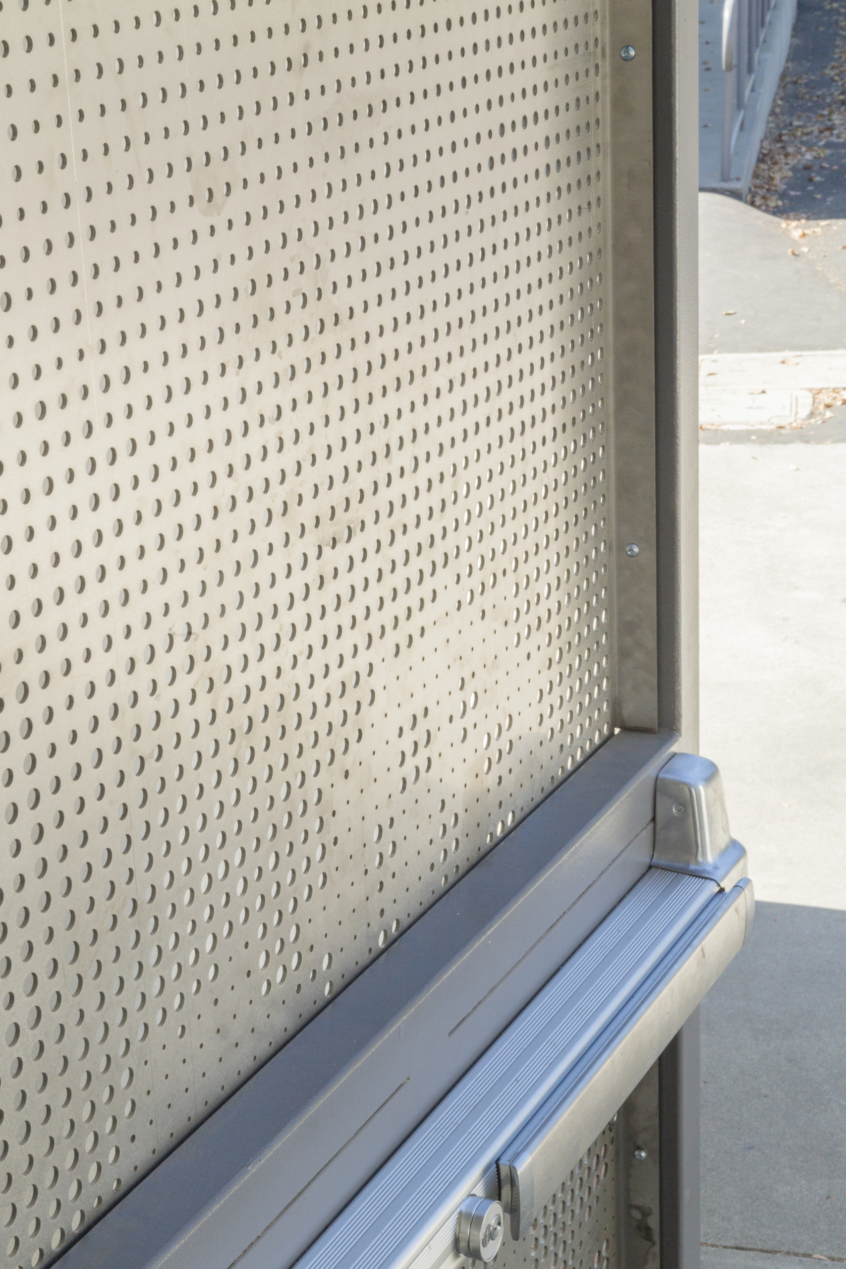 Detail of the perforated stainless steel door.