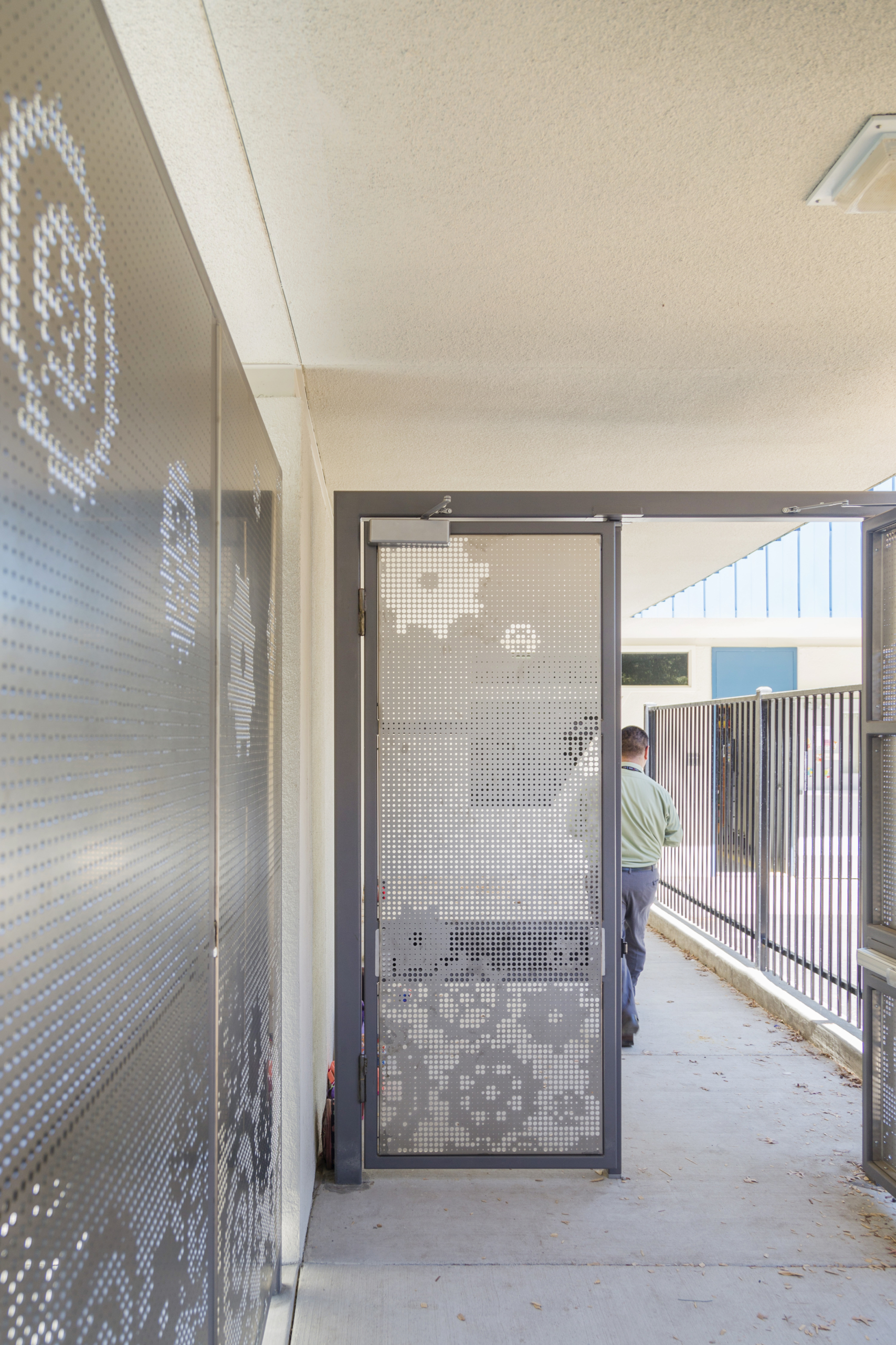 Perforated stainless steel doors at Washington Elementary.