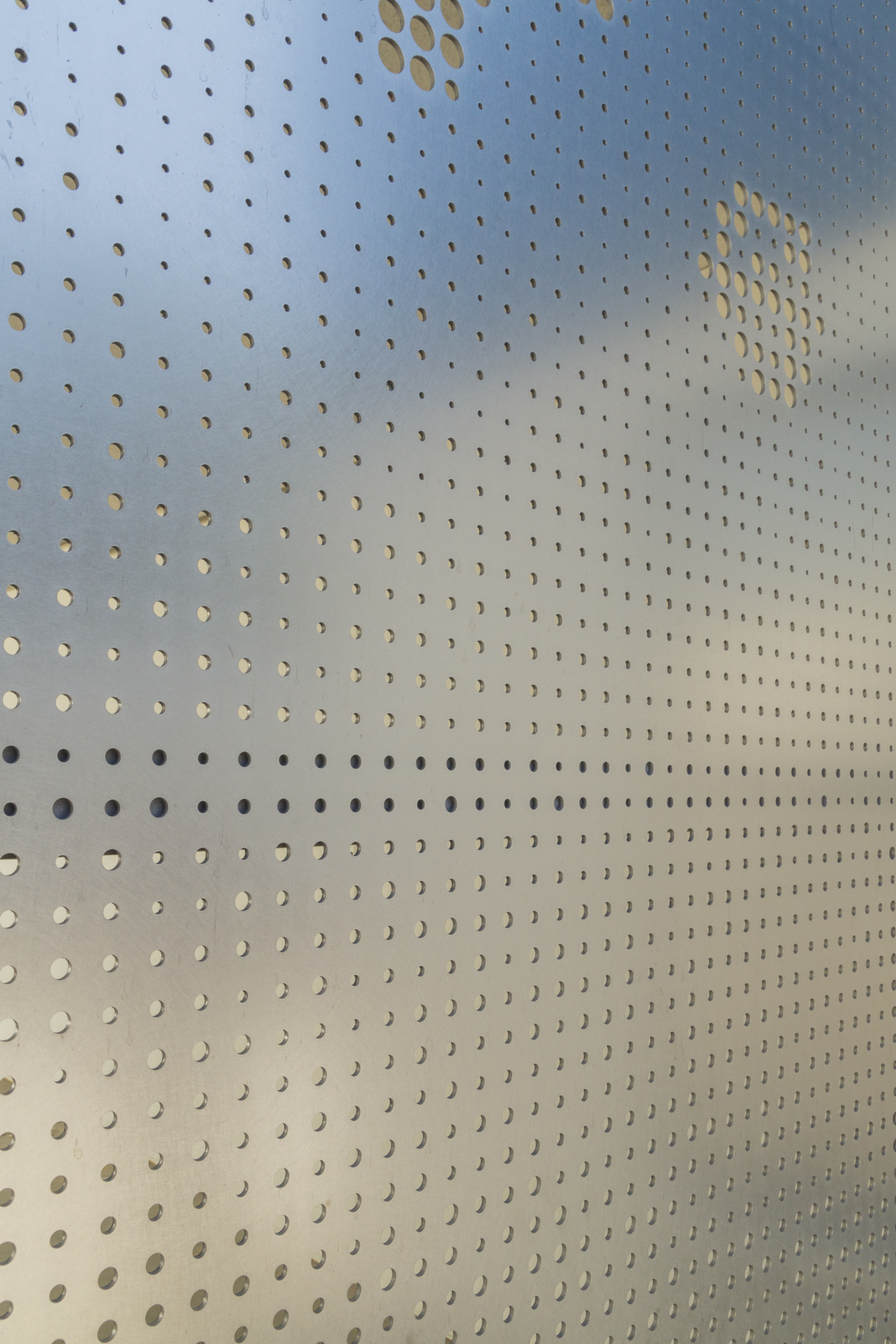 Detail of perforated stainless with Angel Hair finish at Washington Elementary.