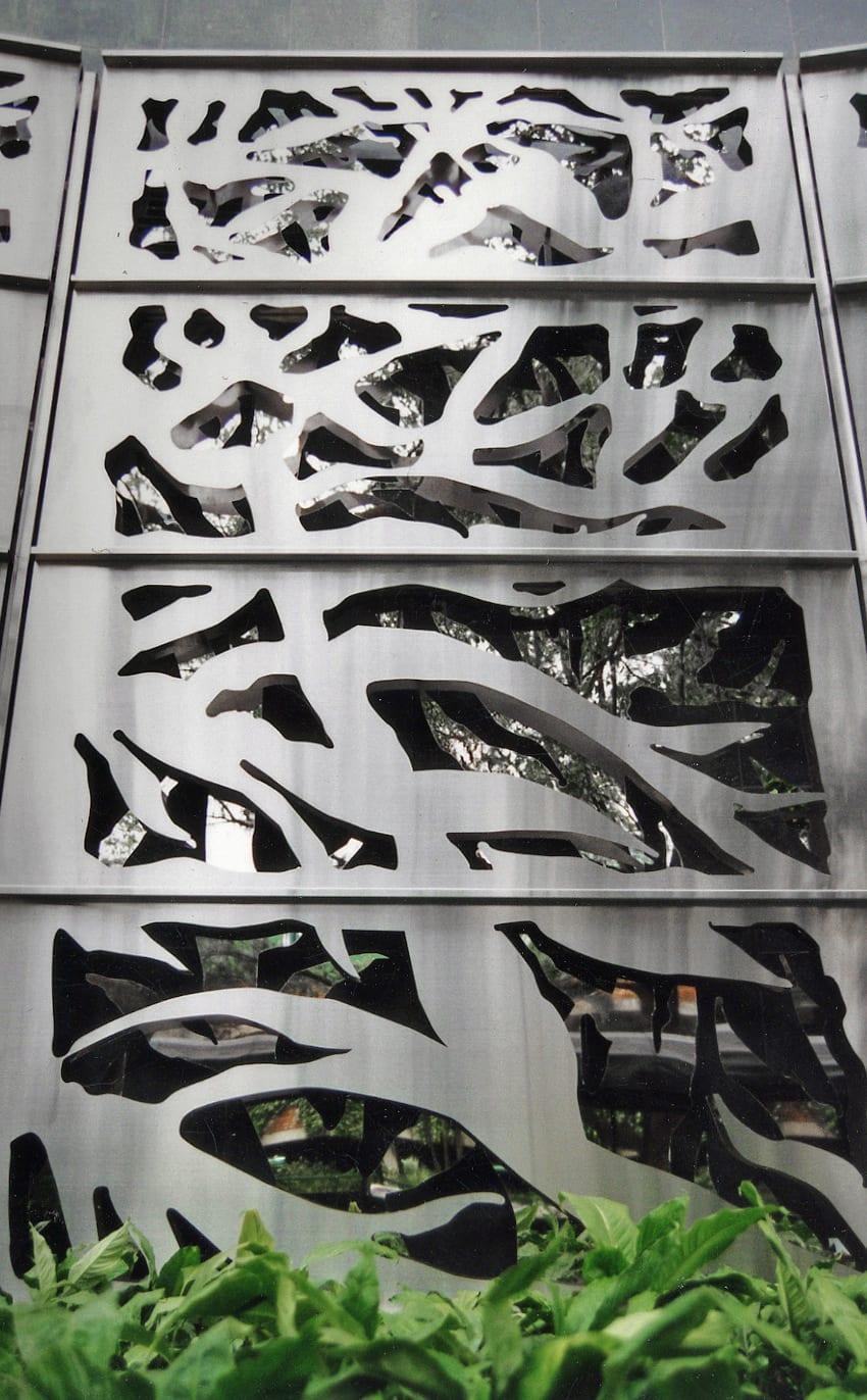 Detail of the custom laser-cut stainless steel panels at Carmen's Garden.