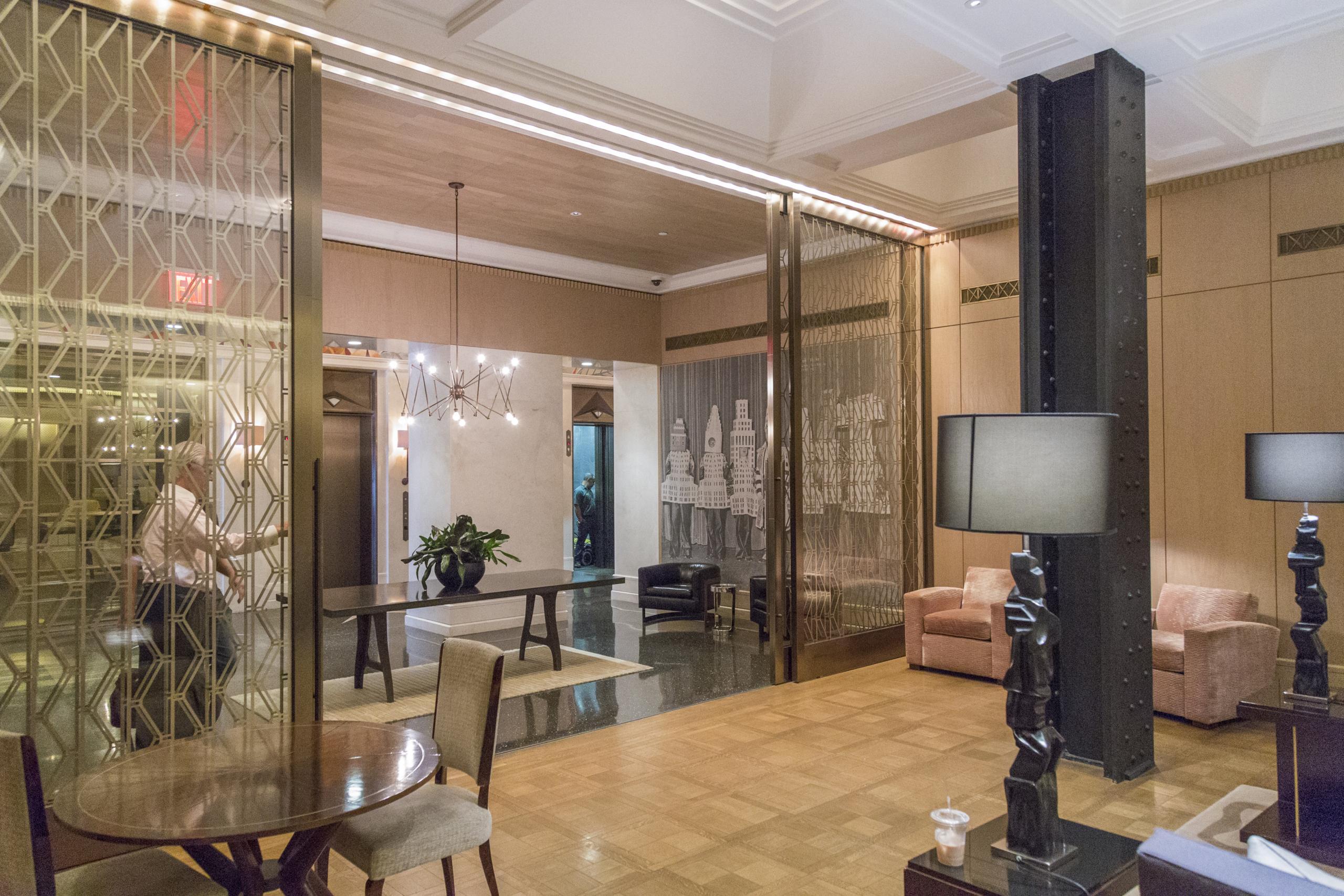 Custom interior glass sliding doors for the Walker Tower lobby.
