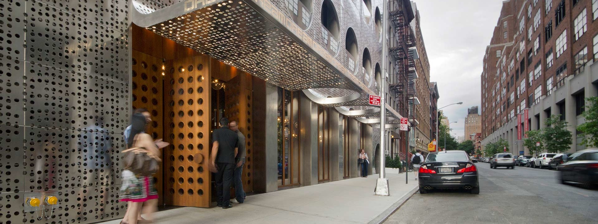 Hotel guests enter the south entrance of the Dream Hotel in NYC
