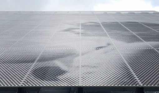 Parking garage facade designed by artist John Baldessari using ImageWall and Angel Hair Stainless Steel.