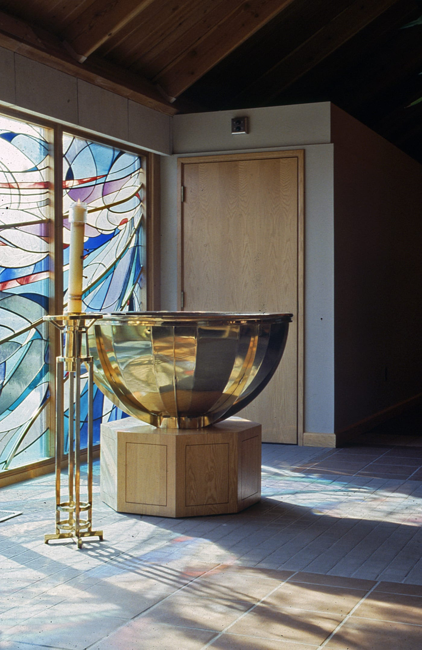 Detail of the inlaid brass used on the stained glass, custom brass altar and candle holders
