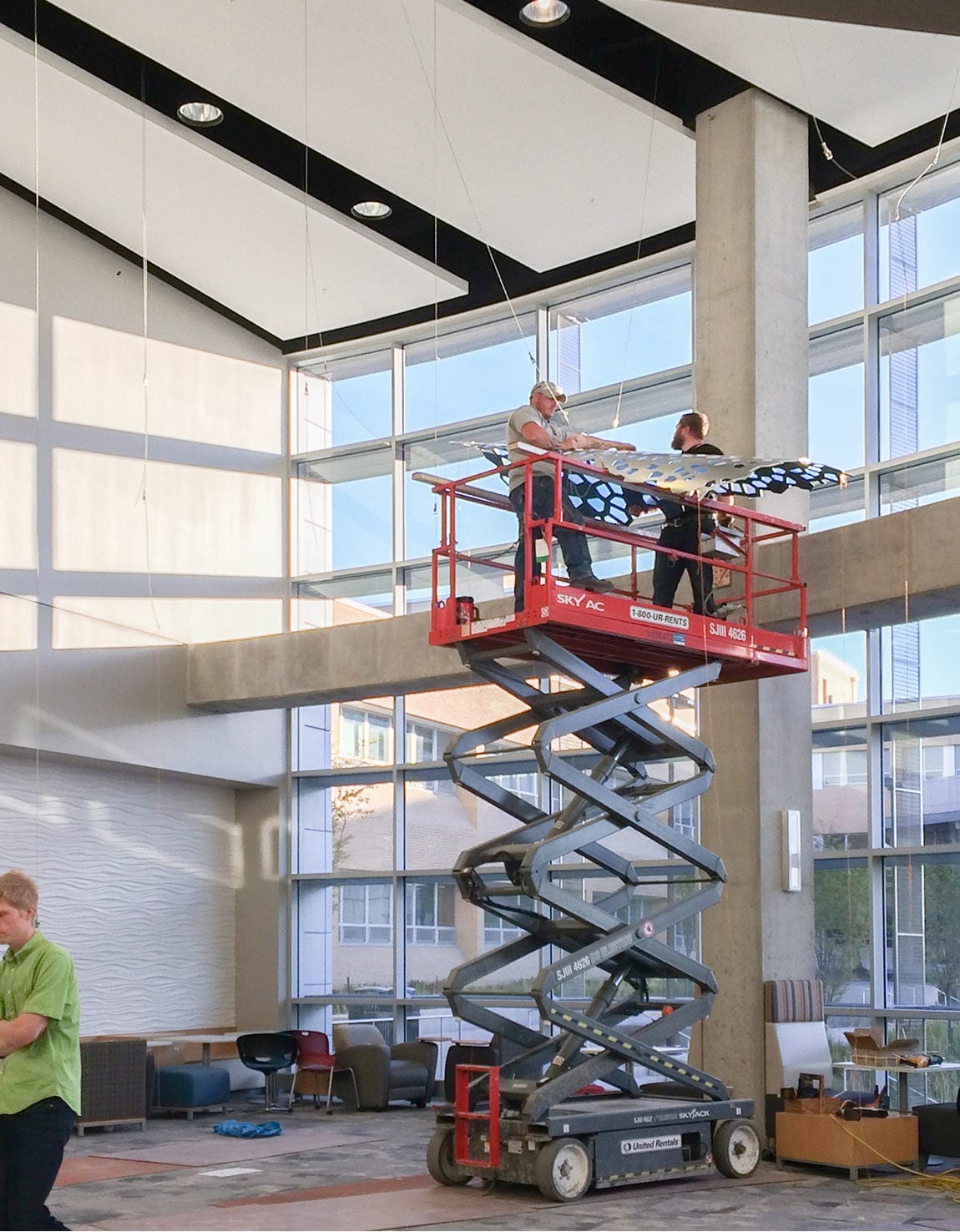 Zahner installers hang the panels using the cable system.