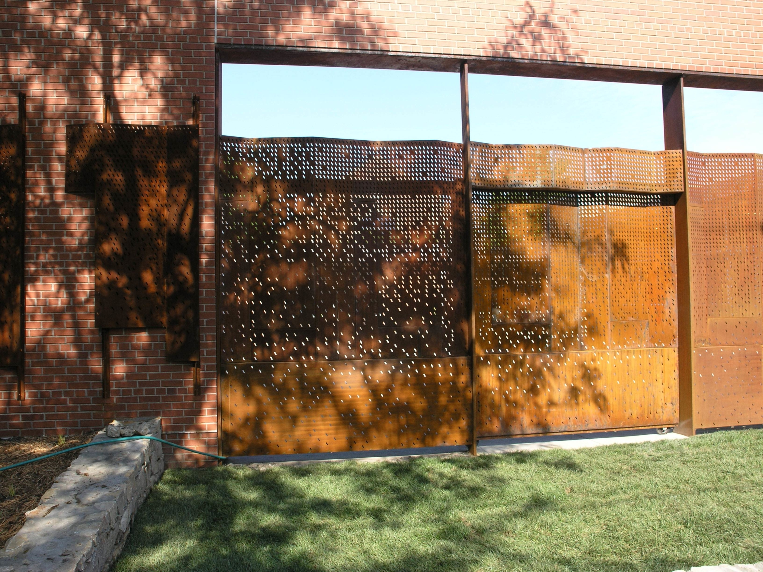 The large gate provides a sense of privacy while allowing for open events at the school.