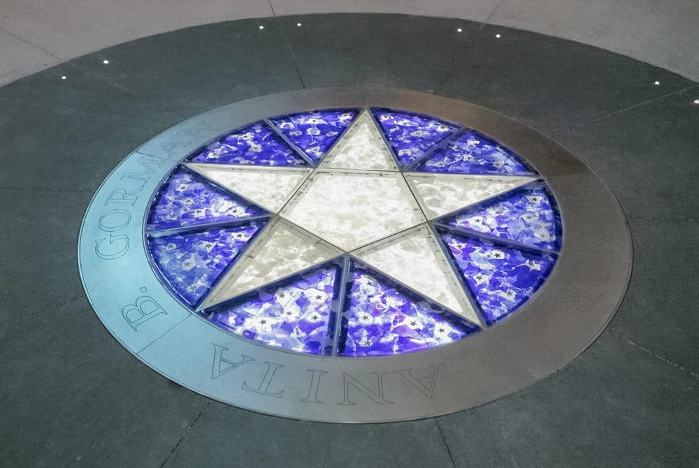 Starlight Theatre Donor's Circle, featuring inset glass with floor and ceiling metalwork.