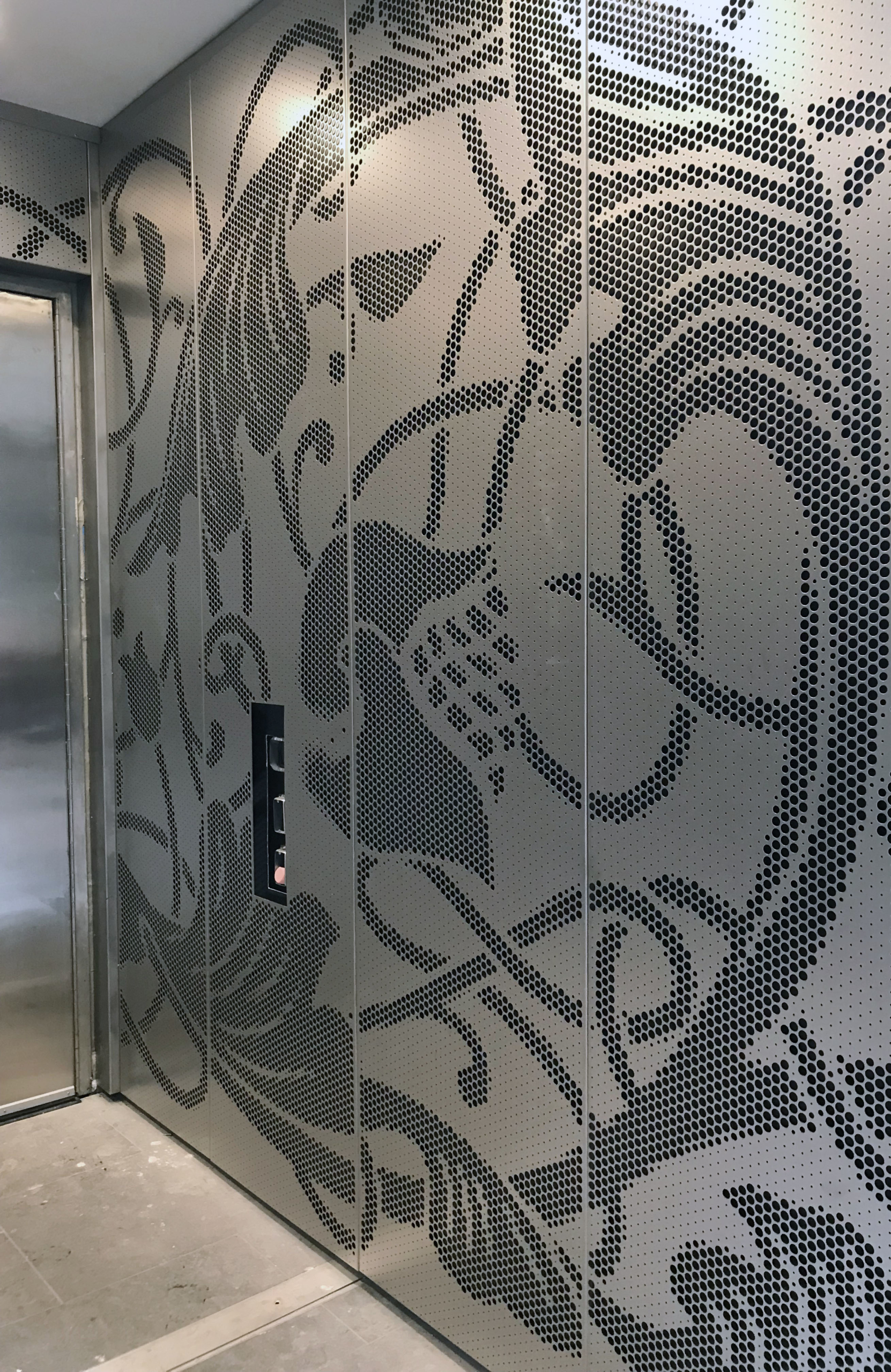 Installation of an ImageWall custom perforated panel system, a Zahner patented process.