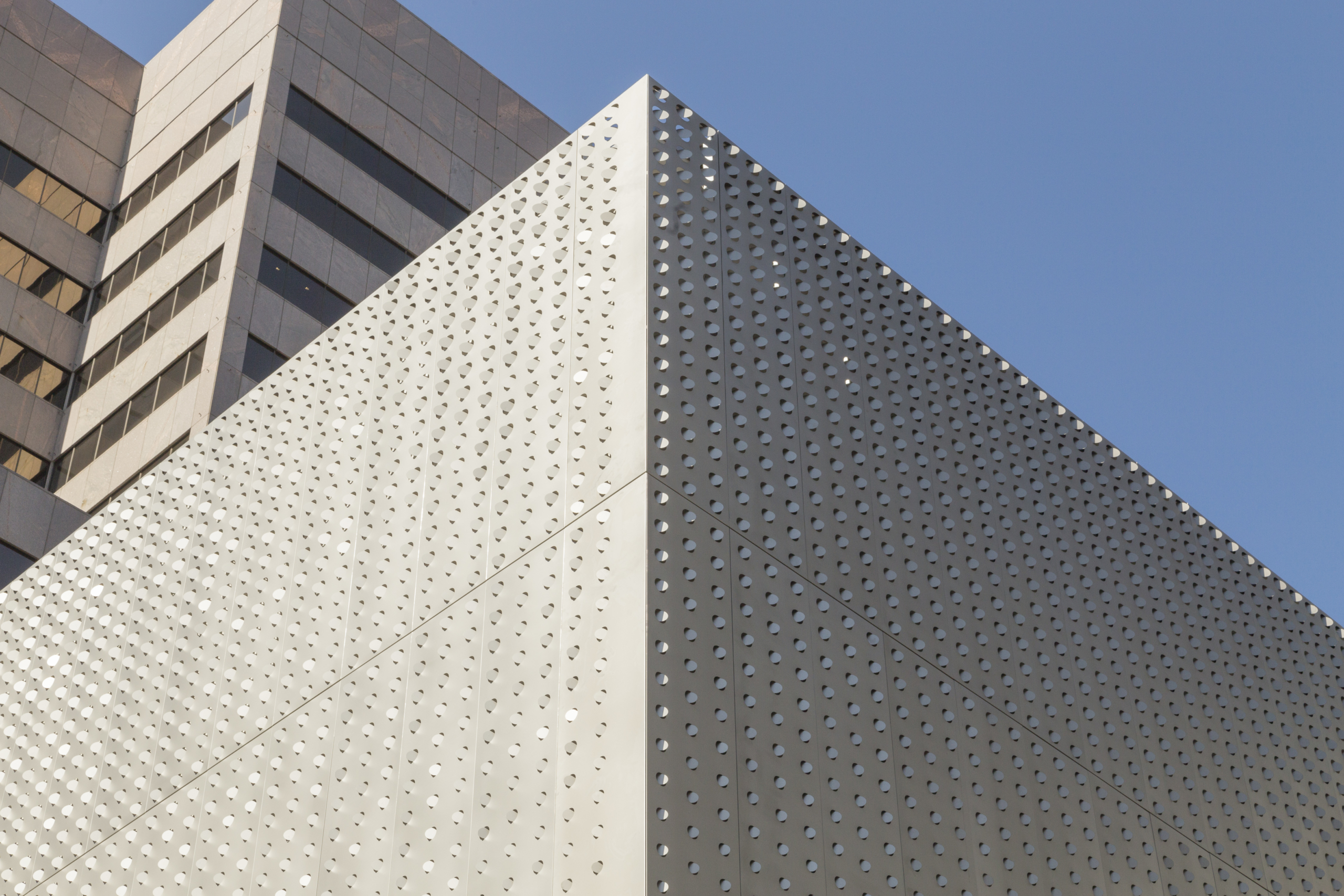 Louvered perforated panels catch and direct sunlight.