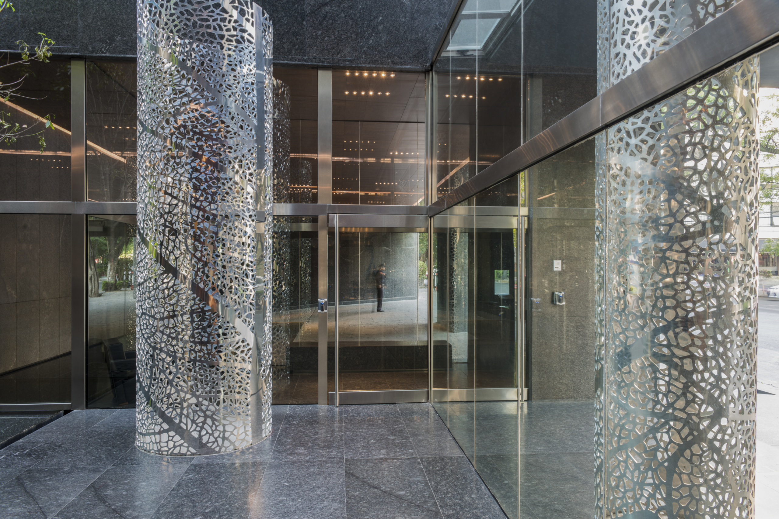 Perforated aluminum columns adorn the entrance of Artesia.