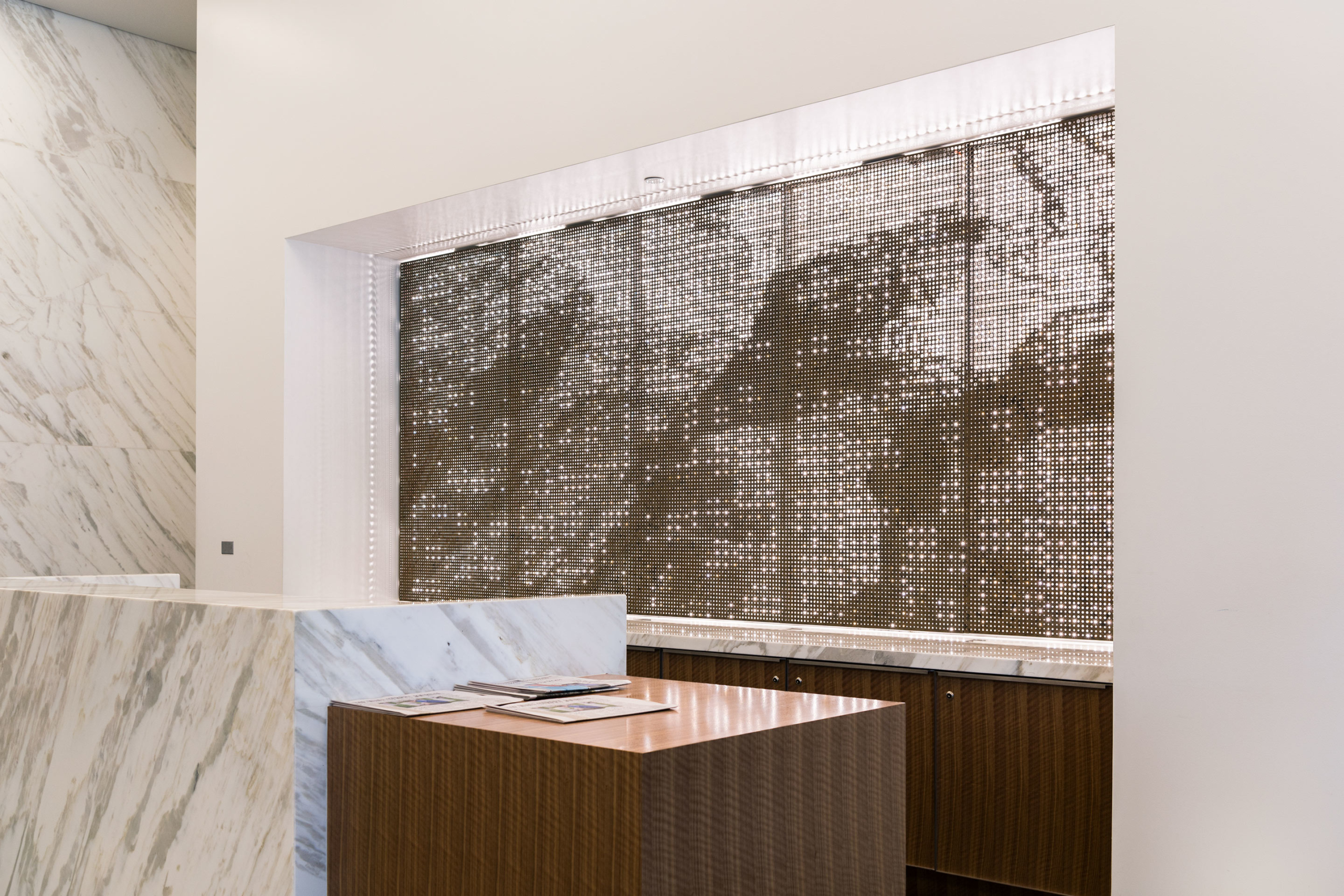 Interior perforated metal at the front desk for 1401 Lawrence.