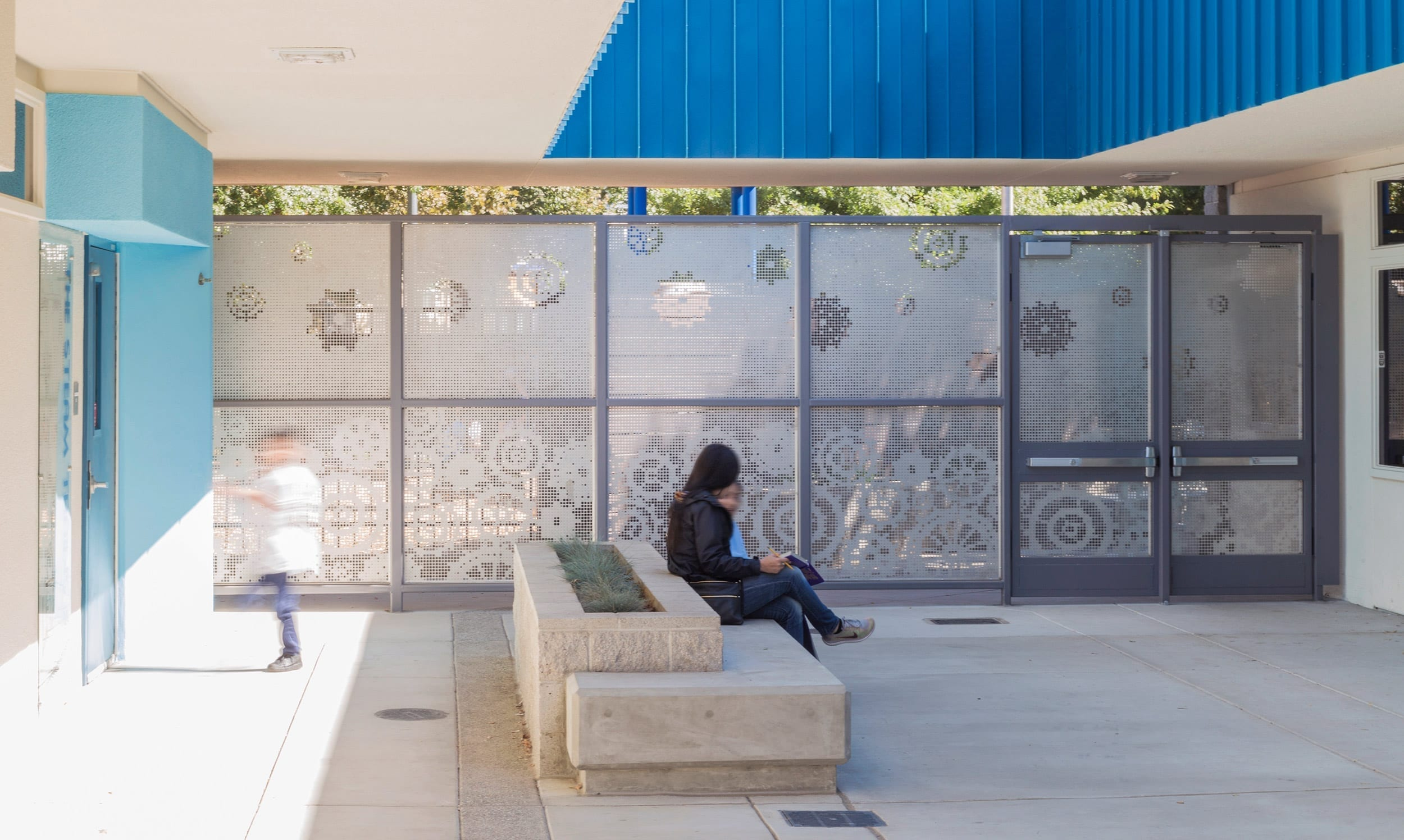 A clever perforated screen wall protects and inspires.