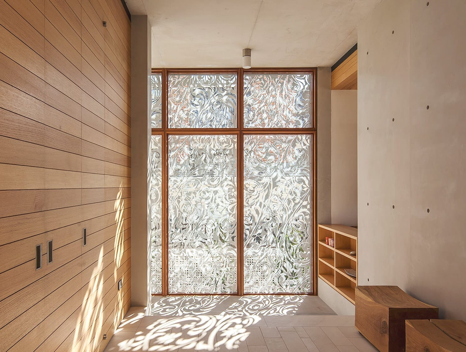 The design protects the interiors while enhancing the space with natural light.