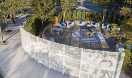 Curved free-standing ImageWall screen in painted aluminum for 1850 Gateway Courtyard.