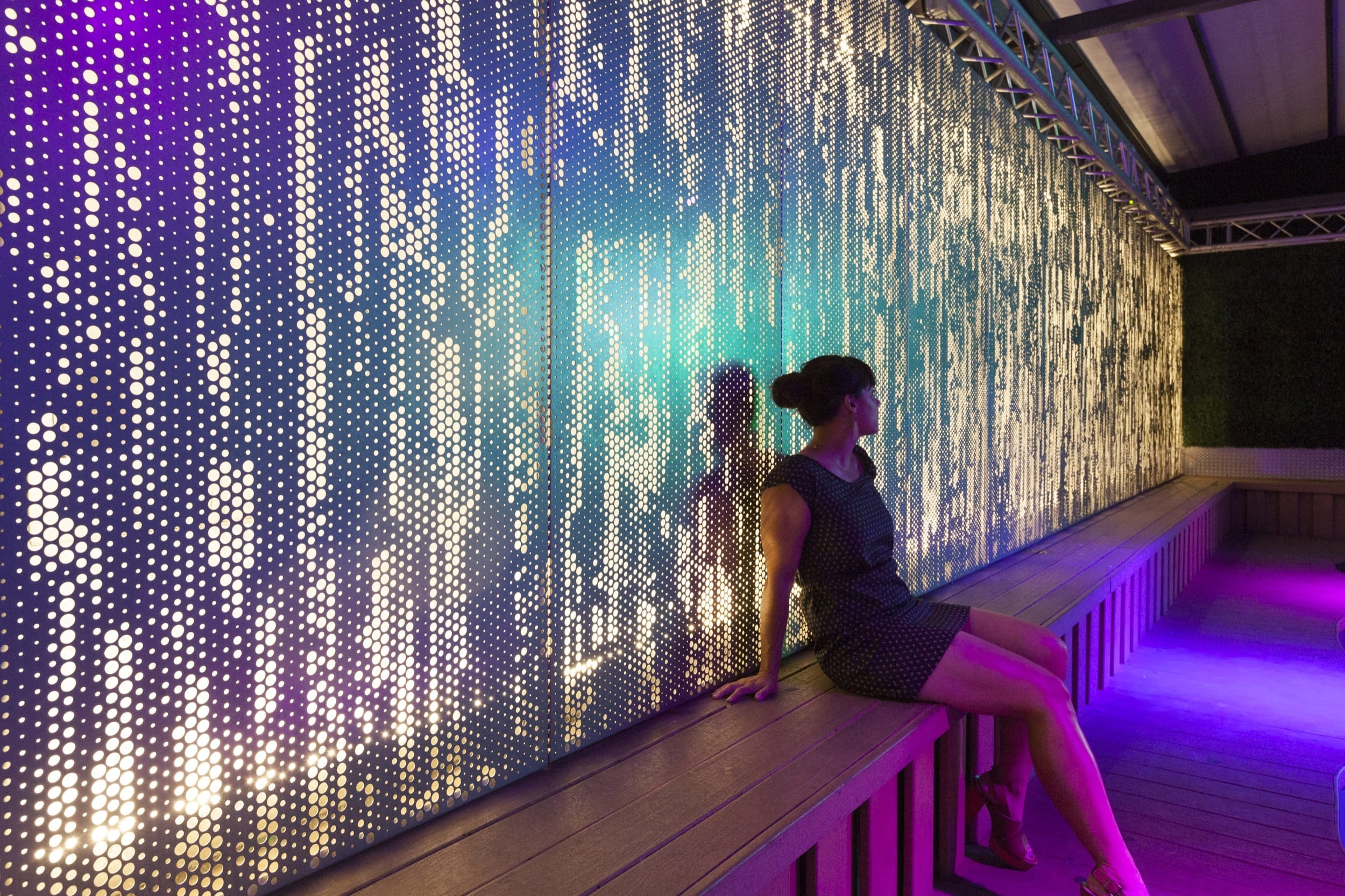 An illuminated ImageWall screen provides a dramatic backdrop for an event space