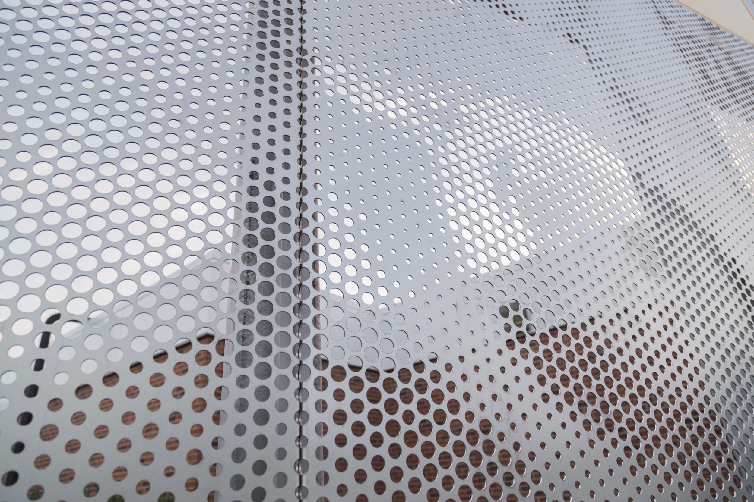 Angel hair stainless steel screens depicting the school's mascot.